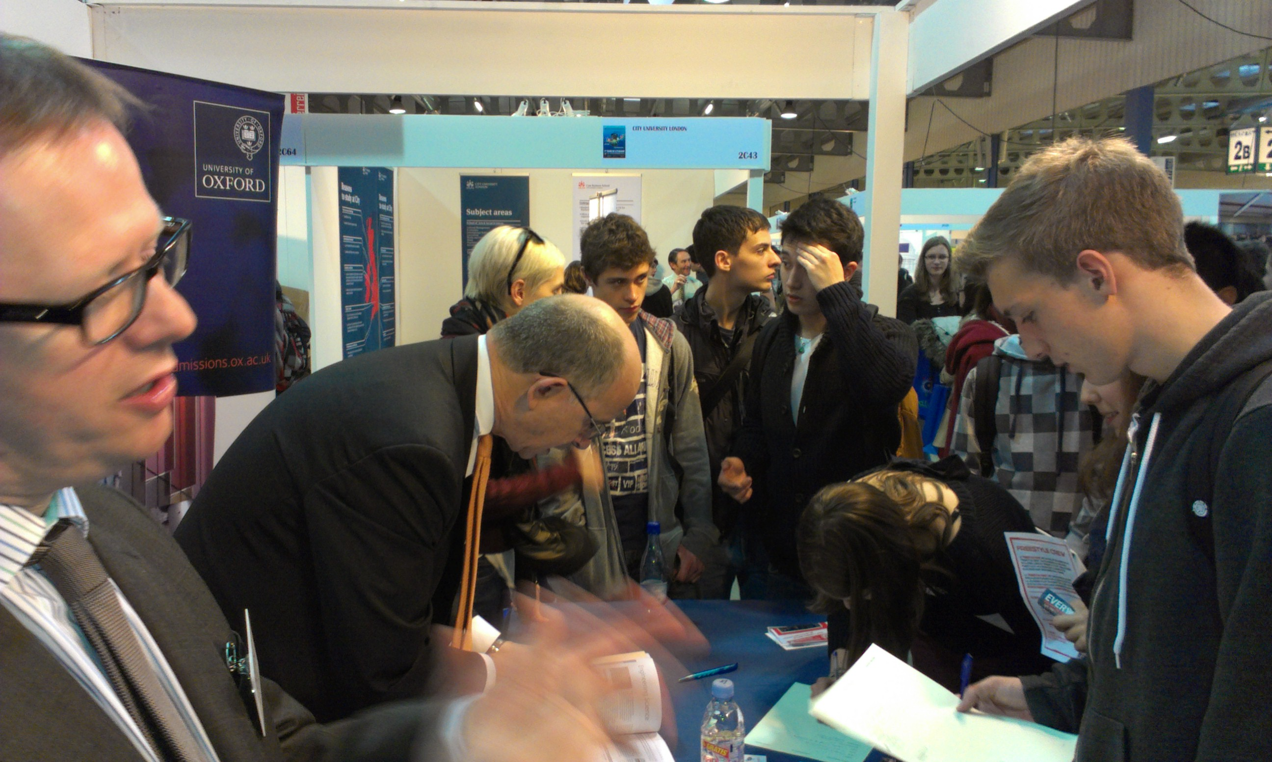 Members and visitors answering enquiries on the Oxford stand