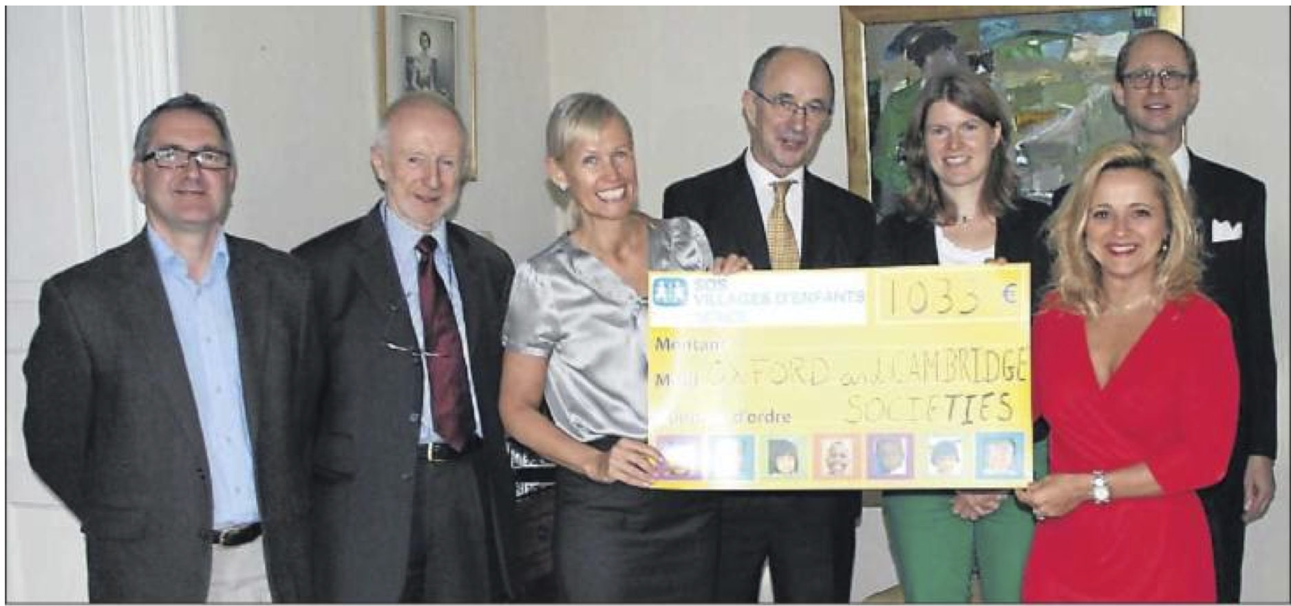Our chairman, former chairman and treasurer, together with Steve Brabbs of the Cambridge society, present the cheque to the representatives of SOS Village d'Enfants in the presence of the British Ambassador, HE the Hon. Alice Walpole