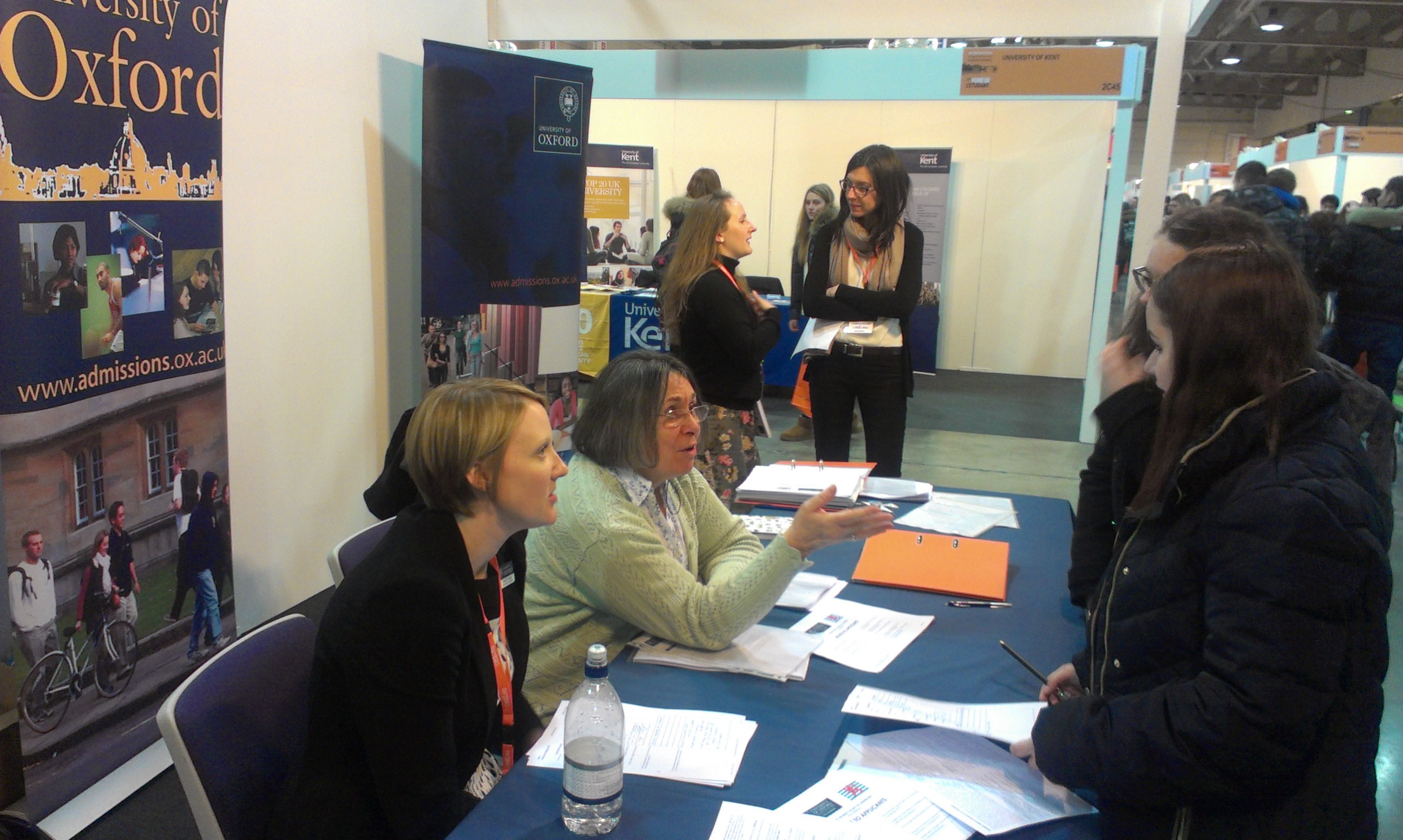 Dr Elizabeth Peachey of the University Admissions Office (left) with OUSL volunteers talking to enquirers on our stand